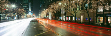 Motion of Cars Along Michigan Avenue Illuminated with Christmas Lights, Chicago, Illinois, USA